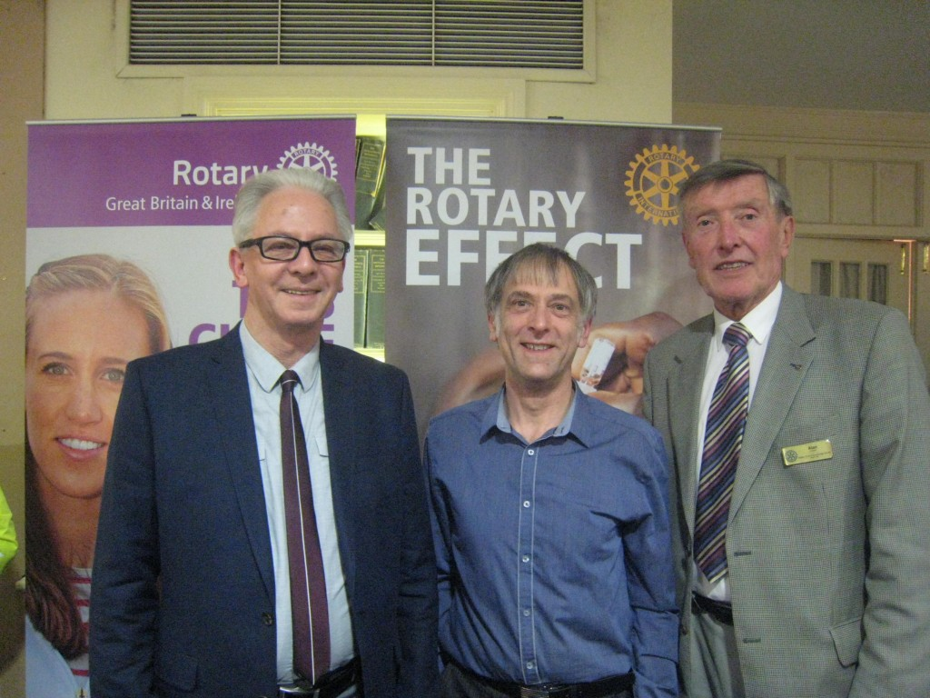 Johan Williams office manager, Alan Franklin Cambridge South Rotary President who presented the cheques and Alan Edwards.